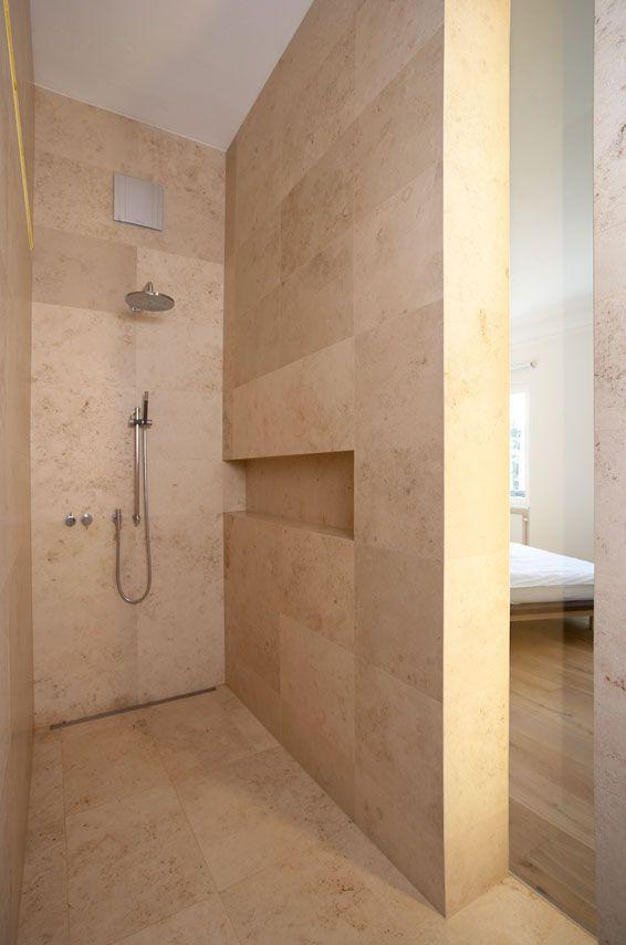Bathroom in beautiful limestone. Berschneider+Berschneider Architekten.