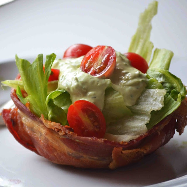 How much do YOU love bacon? I love it so much I made a bowl out of it! Filled it with salad and Avocado Ranch Dressing. Tutorial on cups and recipe for the dressing on my blog.