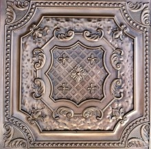 Faux Tin ceiling tile. This will happen in my kitchen some day.
