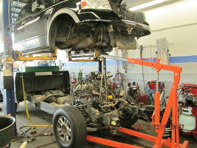 For This 2005 Ford To Gain Access To Exhaust Manifolds To