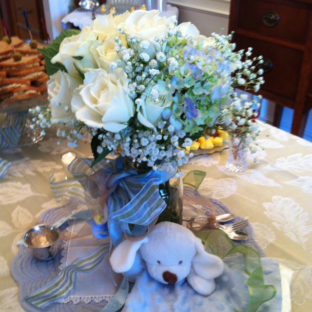Baby shower centerpiece with simple flowers ribbons