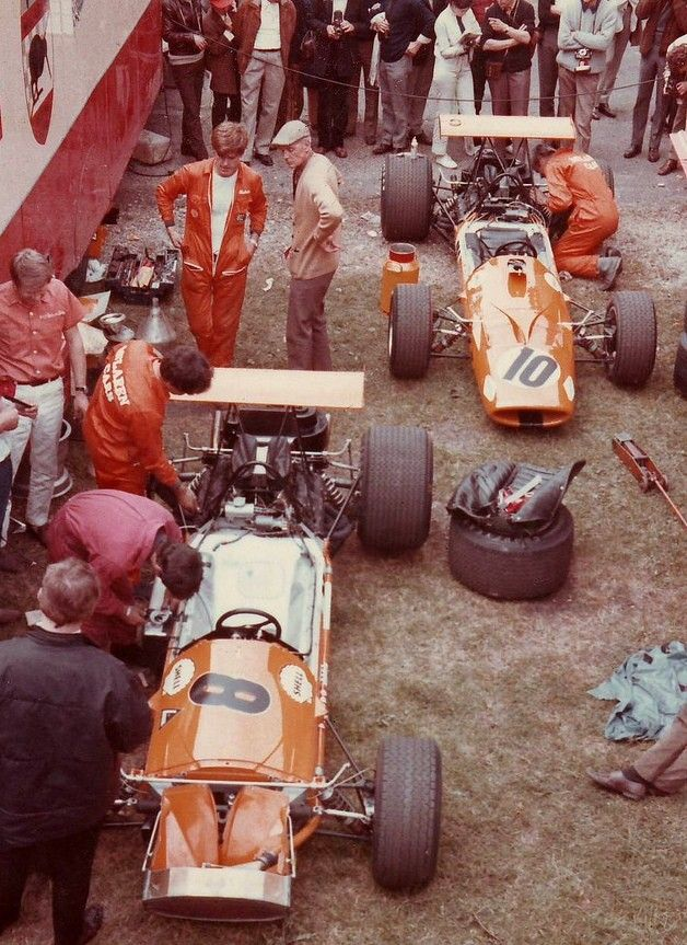 The two M7A McLaren - Fords are being readied in the Pit area for the 1968 French Grand Prix at Rouen, on 7th July. Denis Hulme drove the #8 car into 5th position and Bruce McLaren's #10 finished 8th.