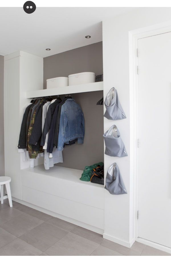 Grey wall behind shelving