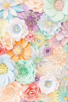 pastel paper flower wedding photo backdrop / http://www.deerpearlflowers.com/paper-flower-wedding-ideas/