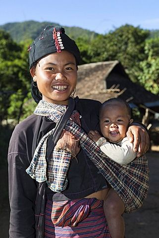 Mother and baby from Ann hill tribe village, near Kengtung, Shan State, Myanmar…