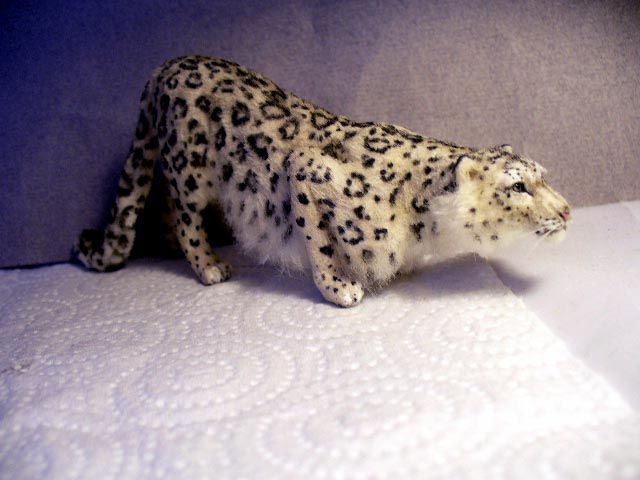Snow Leopard. Hand sculpted by Linda Fisher.  Price: $425.00
