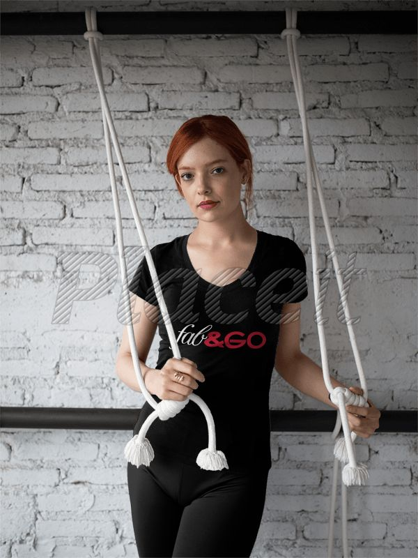 Girl Wearing Custom Sportswear Mockup While Holding Stretching Chords at the Gym a16839Foreground Image