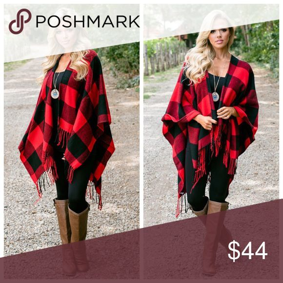 "New red buffalo plaid poncho Classic in black and ivory plaid, our Fall Obsessed Buffalo Check Poncho is essential in this exaggerated print with a fringe hemline. Sport this layer with camel boots for the total effect!   Fringe Hemline Not Lined 24"" from shoulder to hem 100% Acrylic Model is 5'7"" and item is One Size Sweaters Shrugs & Ponchos"