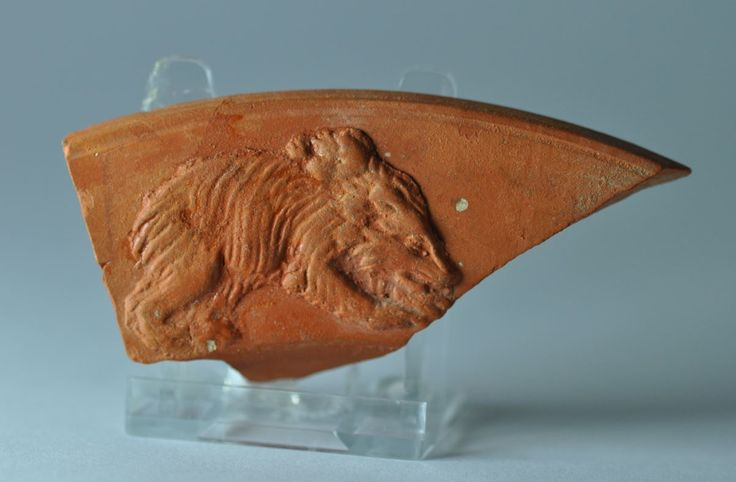 Roman terra sigillata plate fragment with bear, 4th-5th century A.D. African red slip ware plate fragment, North Africa, with bear, 11 cm high. Private collection