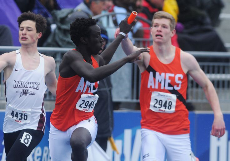 Ames' Will Krapfl hands the baton to Chuol Chuol during the high school boys 4x400-meter relay at the Drake Relays on Saturday at Drake Stadium in Des Moines. Ames finished sixth. Photo by Nirmalendu Majumdar/Ames Tribune http://www.amestrib.com/sports/20170429/little-cyclones-turn-in-strong-showing-with-pair-of-top-six-relays-at-drake