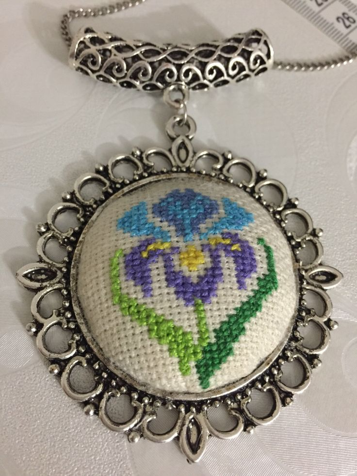 Lily Cross Stitch Necklace, Lily Cross Stitch pendant, Xstitch pendant, Handmade necklace, Gift for her, Embroidered necklace, by Calimerodesign on Etsy https://www.etsy.com/listing/486993189/lily-cross-stitch-necklace-lily-cross