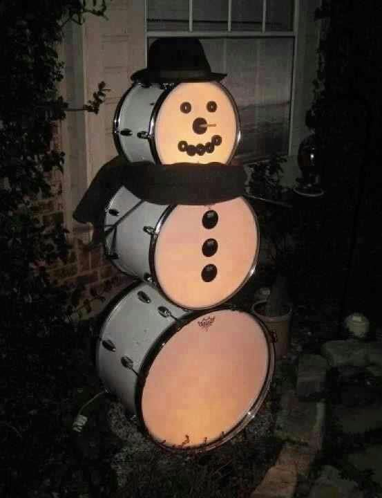 This cheerful snowman made from drums either includes two kick drums and a large floor tom or three kicks of various sizes, all stacked up and decorated very cleverly! Festive! Thanks to Neal Smith...