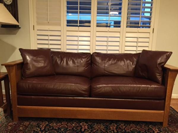Stickley brown leather sofa bed in excellent condition. Slight wear on piping on cushions (see photo). Mattress has never been used (is in original wrapper). Mission-style oak in Fayetteville finish.