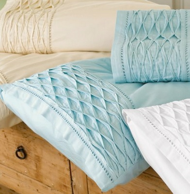 Beautiful smocked pillows. No tutorial on this.  I have seen this done on Sewing with Nancy