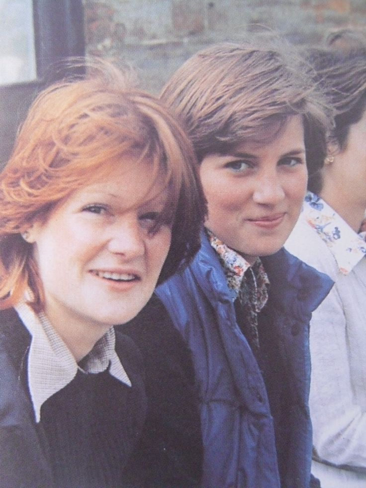 A very young Lady Diana Spencer and her sister Sarah. Looks like in the grounds of Althorp. Diana wearing a blue quilted jacket or vest.