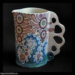 Ceramic decoration in shape of colorful jug. Ceramiczna dekoracja w postaci kolorowego dzbana.