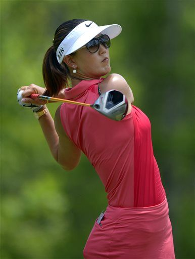 Michelle Wie hits her tee shot on the fourth hole in the final round of the Airbus LPGA Classic golf tournament at Magnolia Grove on Sunday, May 25, 2014, in Mobile, Ala. (AP Photo/G.M. Andrews) ▼25May2014AP|Jessica Korda wins Airbus LPGA Classic http://bigstory.ap.org/article/jessica-korda-wins-leads-airbus-lpga-classic