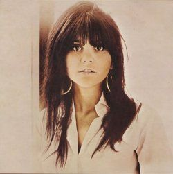 Linda Ronstadt - I love the bangs that just flow right into the rest of the hair... she pulls it off very well.