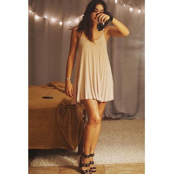 H&M nude flowy mini dress Comfortable, nude mini swing dress by H&M. H&M Dresses Mini