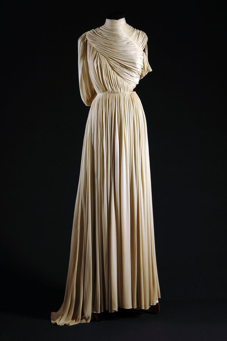 You can see how this gown resembles clothing from Ancient Greece and Ancient Rome