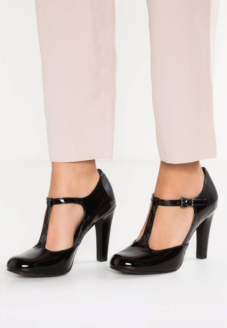 """Marco Tozzi. Classic heels - black . Pattern:plain. Sole:synthetics. heel height:3.5 """" (Size 4). Padding type:Cold padding. Shoe tip:round. Heel type:funnel heel. Lining:textile. detail:elasticated. shoe fastener:buckle/bow. Fabric:Sy..."""