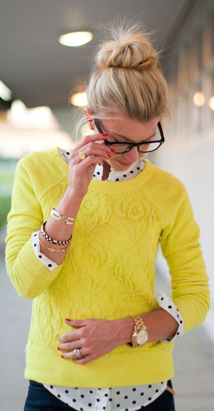 Shop this look on Lookastic:  http://lookastic.com/women/looks/white-and-black-silk-dress-shirt-navy-jeans-yellow-lace-sweater/1038  — White and Black Polka Dot Silk Dress Shirt  — Navy Jeans  — Yellow Lace Sweater