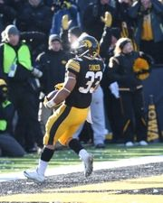 Iowa Hawkeyes running back Jordan Canzeri (33) scores a touchdown against the Purdue Boilermakers in the fourth quarter at Kinnick Stadium. Iowa beat Purdue 40-20.  #8940525