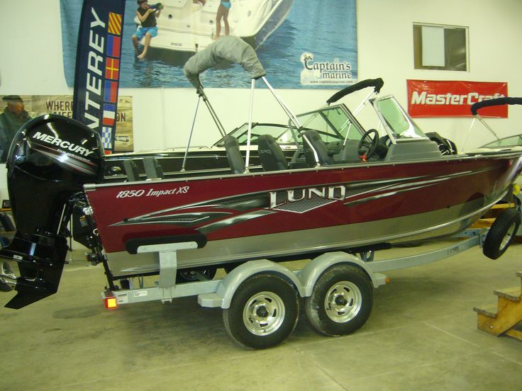 "2015 Lund 1850 Impact XS - The Lund 1850 Impact XS aluminum fishing boats are sure to make an impact on your walleye, muskie (musky), crappie, or bass fishing experience. Equipped to handle all your rods and provide ""small boat"" usability, this is one of the best new aluminum boats for sale today. With the addition of flip-up seats, and a ski pylon, the near 19' 1850 Lund Impact XS is the perfect fishing and sporting boat for you."
