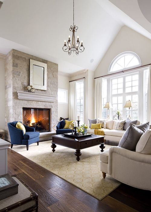 Learn all about Benjamin Moore Ballet White as shown in this living room by Jane Lockhart.  Love it with the stone fireplace and navy blue accent chairs.  #BalletWhite #BenjaminMoore #BestPaintColours