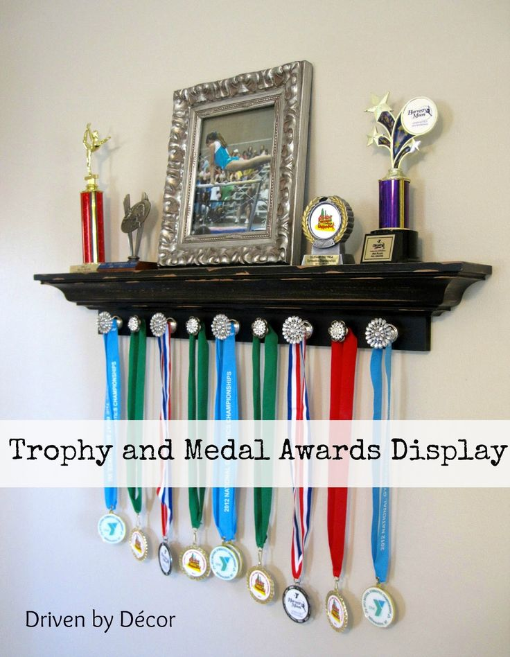 Attach decorative knobs to a ledge shelf for trophy and medal awards display