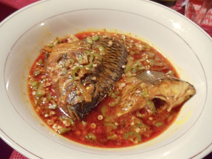 Okro soup with fish (and yes, fish have heads, deal with it!)