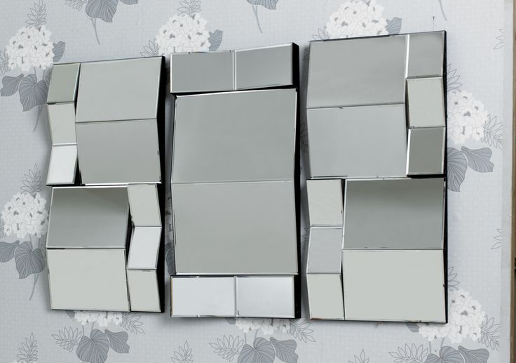 The Trilogy is a remarkable set of three mirrors. Sections on each mirror are rectangular, but different sizes, and set at multiple angles. An unusual contemporary design. Though they are a set, use your imagination in placing these mirrors - close together or far apart. You'll never tire of the interesting effects created by these mirrors! http://www.chicconcept.co.uk/mirros/1462-trilogy-set-of-3-multifacet-mirrors--5055157622292.html