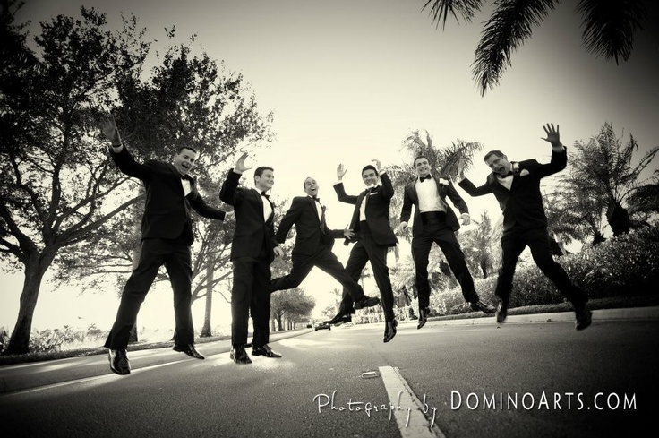 Everyone had fun in front of (and behind!) the cameras. Not one photo we captured lacked a smile. Arms were always in the air! #Wedding Picture by #DominoArts Photography (www.DominoArts.com)
