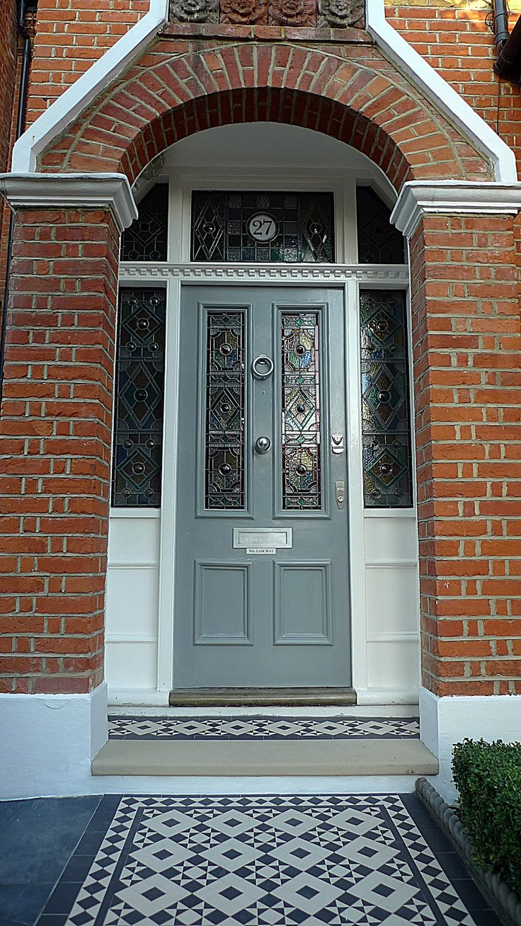 Victorian Mosaic tile part in beautiful front garden design Battersea.  Fine details around the porch including York stone beautifully detailed Mosaic tile long and wide Victorian Mosaic tile path with York stone entrance, row page tiles and box hedging with formal mixed front garden planting.