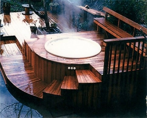 Wood deck around hot tub. - amazing set up. .. My house WILL have a hot tub, even if it means that my house is made of card board.