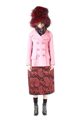 Soft pink cashmere doubleface pea coat. Pleated darting at back, oversized faux pocket flaps, and large acrylic buttons.60% Wool. 30% Cashmere. 7% Angora. 3% Lycra.