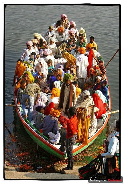 Gathering together in a boat to attend a religious ceremony in India