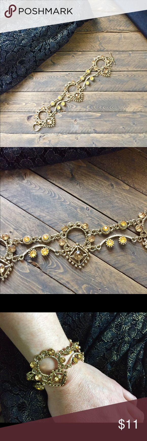 "💕 Gorgeous antiqued bracelet Very unique antique gold colored chunky bracelet with jewels of marigold. Perfect to wear for that special occasion out. Hook and clasp closure and measures about 8"" in length. Excellent condition and no missing stones. Home is smoke and pet free ✌️️🌺 Jewelry Bracelets"