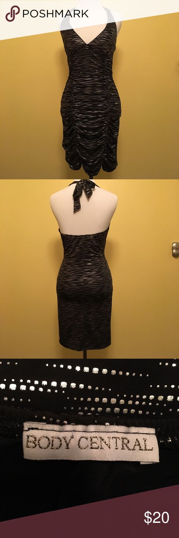Body central black and silver dress Body central black and silver dress, very simple but dressy. cute scalloped bottom.  For a fun night on the town Body Central Dresses Mini