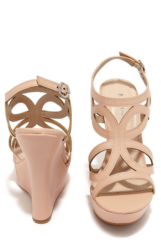 "We're not too proud to beg; especially when there are shoes as cute as the Pretty Please Nude Caged Wedge Sandals! Textured vegan leather sculpts a caged peep toe upper with an adjustable ankle strap, and silver buckle. A 5.25"" wrapped wedge heel slides into a 1.25"" toe platform. Cushioned insole. Nonskid rubber sole. Available in whole and half sizes. Measurements are for a size 6. All vegan friendly, man made materials."