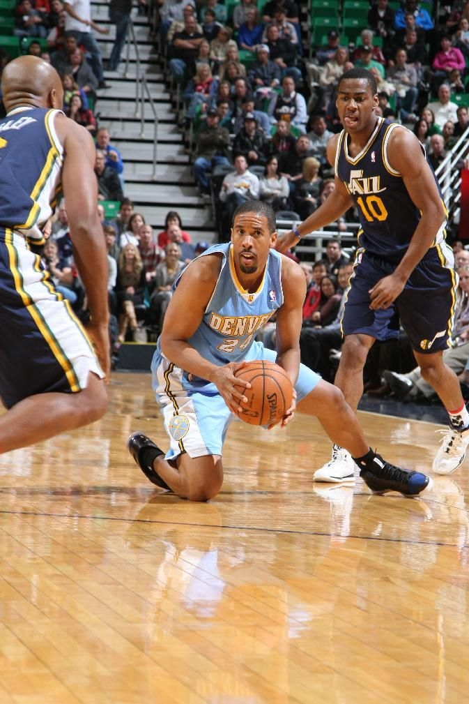 SALT LAKE CITY, UT - NOVEMBER 11: Andre Miller #24 of the Denver Nuggets gains control of the ball against Alec Burks #10 of the Utah Jazz at EnergySolutions Arena on November 11, 2013 in Salt Lake City, Utah. (Photo by Melissa Majchrzak/NBAE via Getty Images)