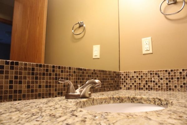 Granite counter tops and mosaic tiles in the bathroom add for Mosaic tile bar top