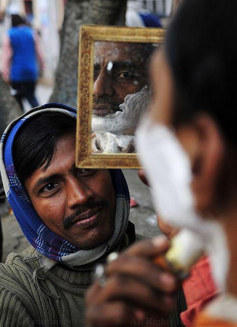 Street barber in Kolkata, India