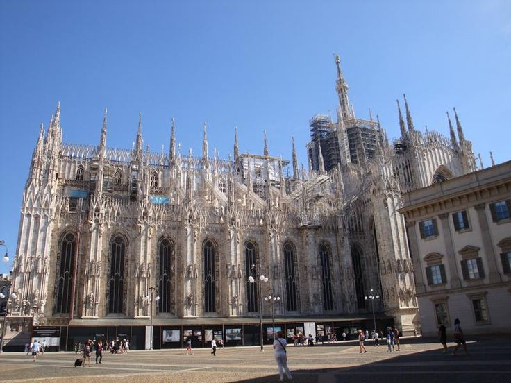 Photo about Duomo`s lateral facade on a sunny day - July 2017 - Milan - Italy. Image of frontage, mary, details - 111277837