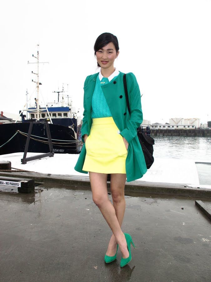 collar shirt. sweater. mini skirt. pumps - the colors look like a @Gabrielle outfit :)