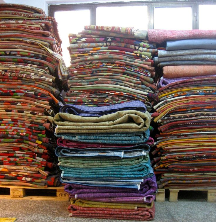 Colorful carpets piled in our shop...