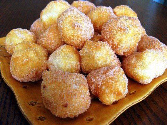 "Dragon's Kitchen: Sonhos - Sonhos are a traditional Portuguese dessert of fried dough rolled in sugar. Sonhos means ""Dreams"". I'm told the reason they are called dreams is that you will think you're dreaming when you bite into one of these little puffs of happiness."