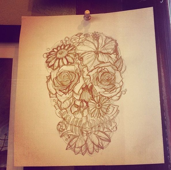 Flower skull tattoo. Like the hibiscus at the top and the chin.