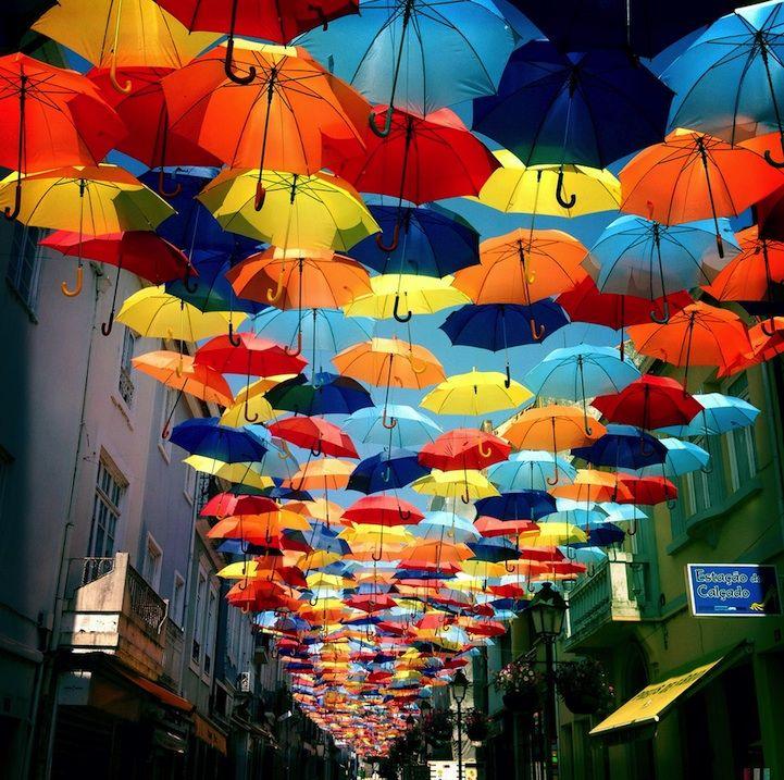 Colorful Canopies of Umbrellas by Sextafeira Produções