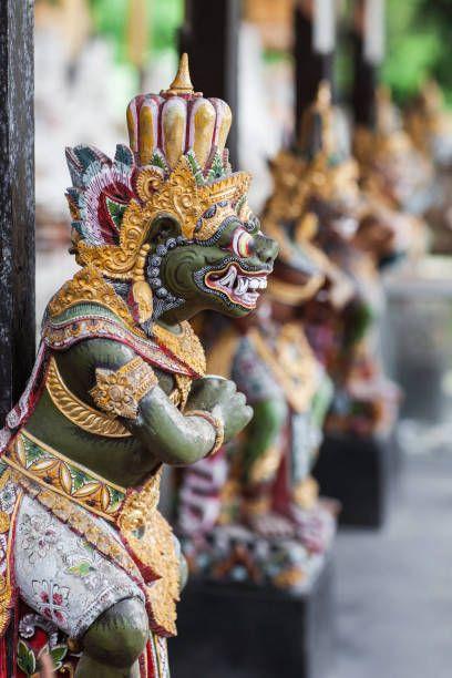 wooden statuette of the deity in balinese temple goa gajah